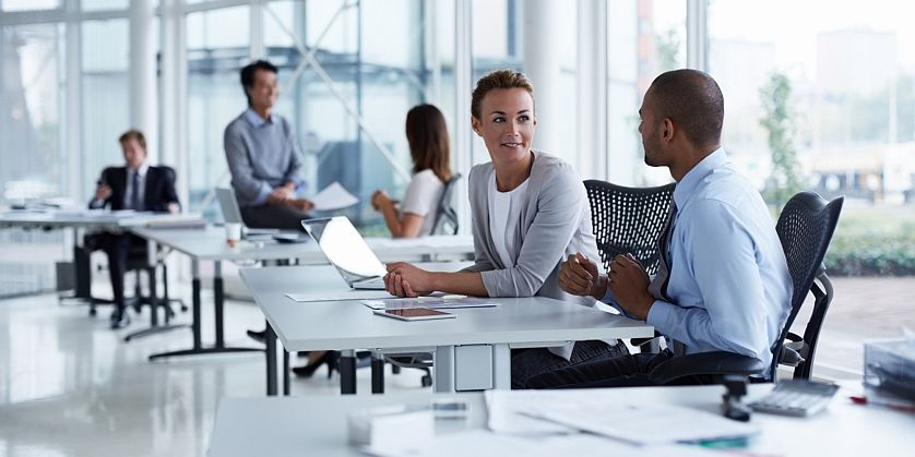 SAP people discussing in office